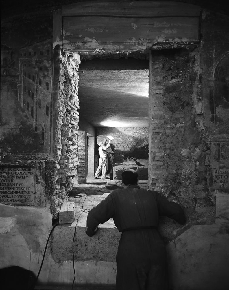 archaeologist examining a chamber